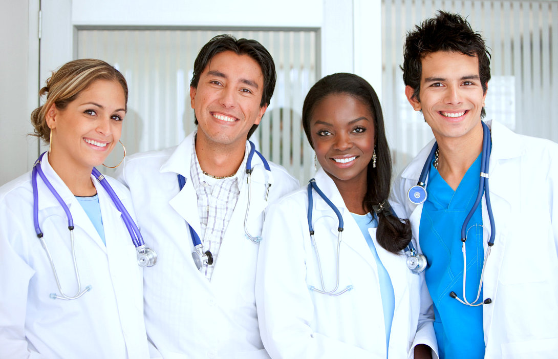 A group of doctors standing at the hospital smiling
